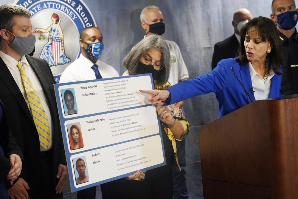 Photo: AP Champlain Tower Press Conference ID Theft